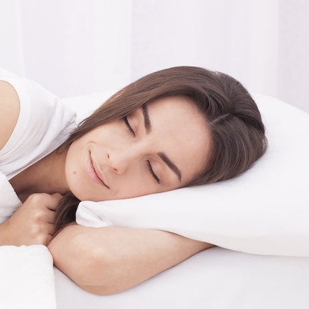 Woman sleeping during her appointment thanks to sedation dentistry in White Plains NY