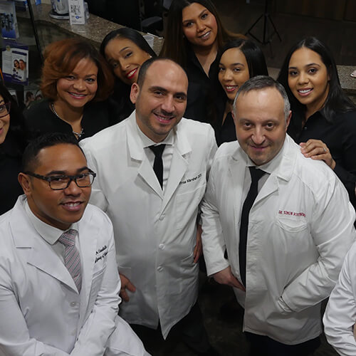 Shot of our dental team smiling