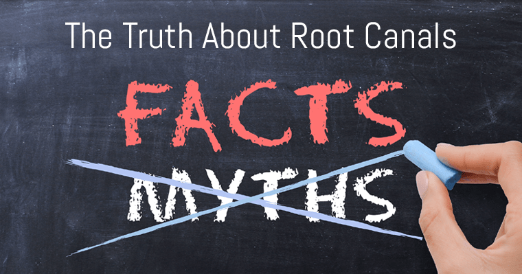 Chalkboard with hand crossing out myths about root canals