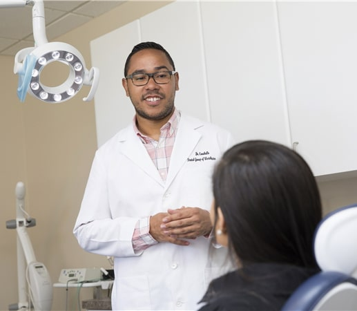 Doctor at Dental Group of Westchester discussing treatment with patient