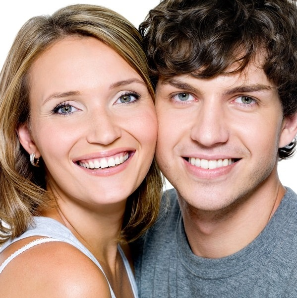 Man and woman with beautiful smiles because of Snap-On Smiles.