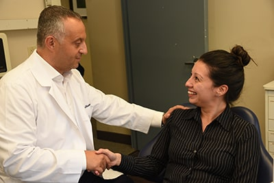 Photo of Dr. Simon Roytberg talking with a patient