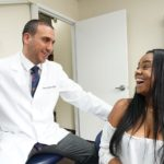 White-Plains-dentist-Dr-Marsheh-talking-to-a-patient-from-White-Plains